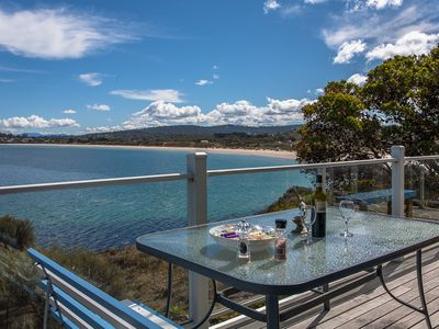 Alfresco dining on the front deck watching the waves lap on the beach.