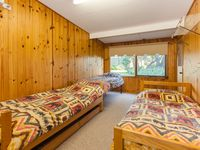 The dormitory in kookaburra Cottage sleeps six, with the trundle bed.