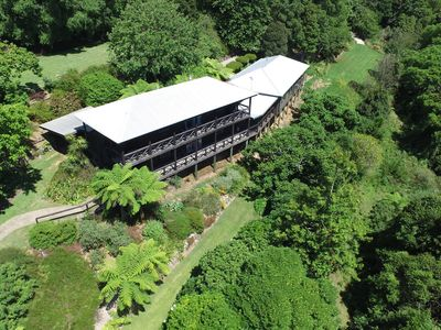 The Retreat set in landscaped gardens and overlooking rainforest