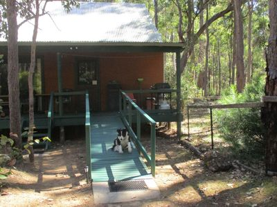 Chalet 1 with ramp and dog yard. Wheelchair friendly bathroom and facilities.