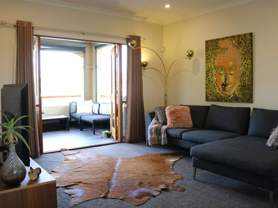 Your private lounge leading to balcony - TV Foxtel, DVD