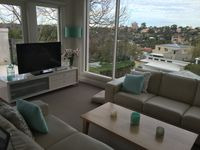 lounge room with view and TV