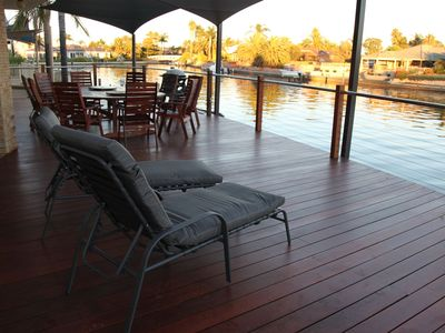 The spacious deck complete with 9 seat outdoor setting and BBQ and 2 lounges