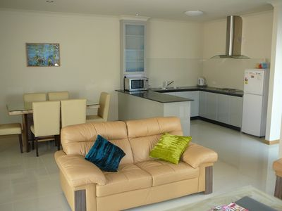 Lounge, Kitchen & Dining with Air conditioning
