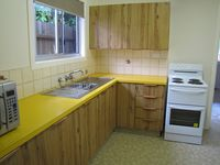 Kitchen - fully equipped with electric oven, microwave and large fridge