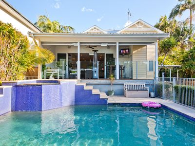 Backyard with pool & spa which seats 8