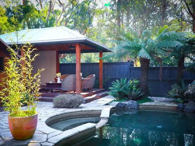 Beautiful secluded pool area with spa, sauna and pool house.