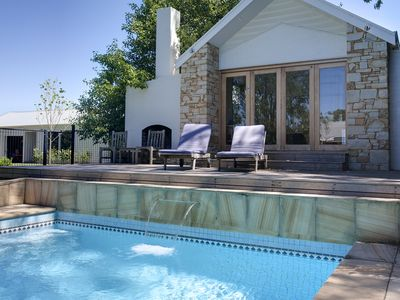 Pool house with outdoor fire and Swedish hot tub