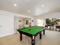 Games room features pool table