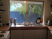 Fully equipped kitchen with frig, electric cooker, microwave