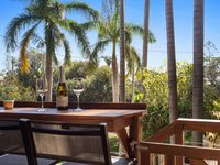 Enjoy al fresco meals and drinks at sunset on the balcony