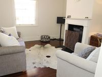 Tastefully styled interior with open fire and foxtel
