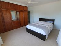 Large main bedroom. Open the windows for cool sea breezes.