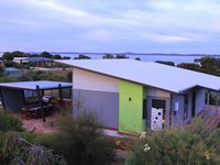 Coorong Cabins. Pelican Cabin sleeps 4 and features two king bedrooms