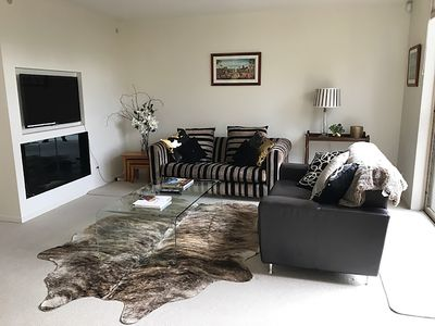 Living room with wall mounted TV and ethanol fire