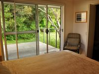 Upstairs queen bedroom with private veranda and ensuite