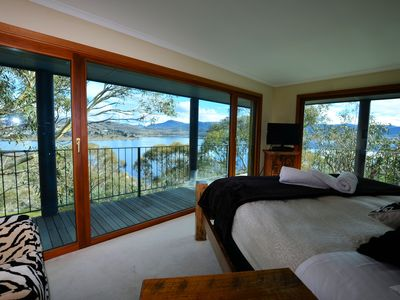Master bedroom -stunning views, king size bed fit for a queen