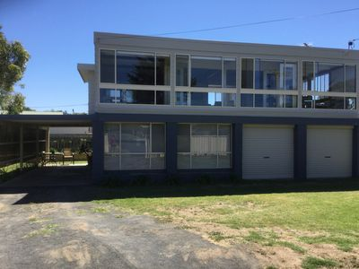 House within 400 metres of the beach with large garden for the kids to play