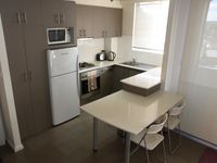 self catering kitchen and dining: Parramatta View Furnished Apartments