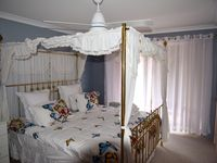 Twilight Room with king size poster bed and king single bunk bed with trundle