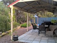 Rear al fresco with outdoor table and chairs and gas barbecue