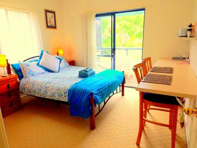 Double queen bed with breakfast bar, microwave and kitchenette,balcony access