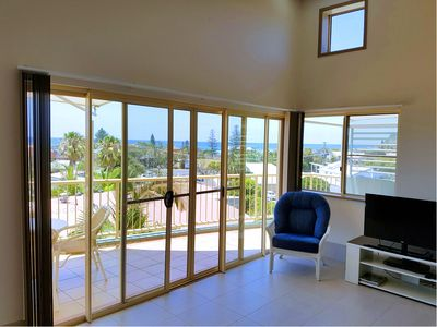 1 BR Seaview Spa Apartment Lounge and balcony