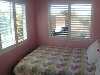 Fourth bedroom with double bed, adjoins second bathroom