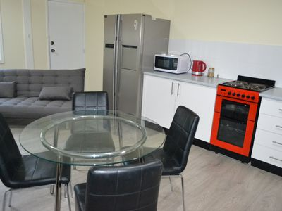 Downstairs kitchen, dining and TV area