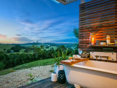 Undercover outdoor bath - evening. Super Luxe
