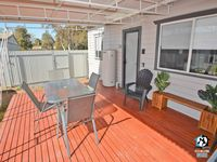 Private deck area, fully covered and protected.