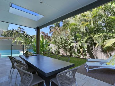 Outdoor furnished area, overlooking private garden and pool area