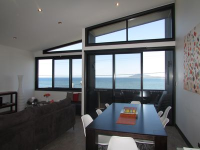 Living / Dining area with views over Seven Mile Beach