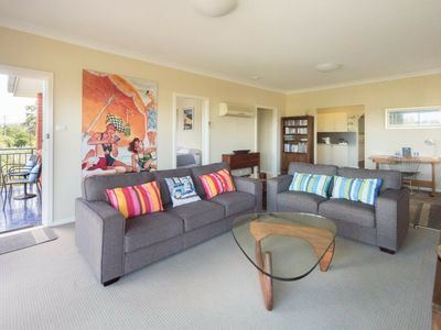 Spacious front living room with TV/DVD/Netflix, ocean views & balcony access