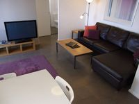 open style living room, lounge, dining, TV: Parramatta View Furnished Apartments