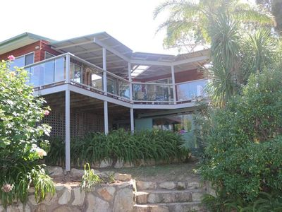 Spacious beach house with magnificent deck provides beautiful views.