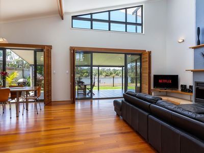 Open-plan living and dinning overlooking the beautiful waterway