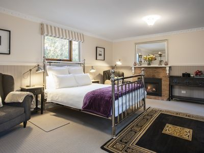 Camellia - Bedroom/Living Area. Queen bed with electric blankets, gas log fire