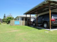 Carport and plenty of room for extra cars
