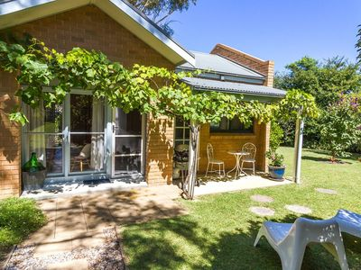 Beautiful renovated cottage situated in large garden away from main house.