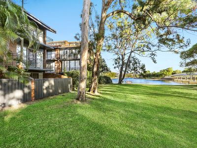 Featuring pool, balconies and rear courtyard with easy access to river.