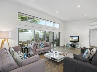 Settle into your living room at Living the Beach Dream