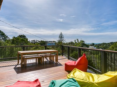 Expansive deck with views across the water and to Melbourne beyond.