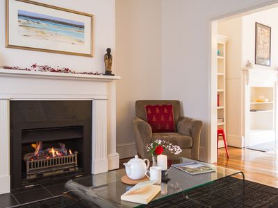A cosy gas fire supplements a reverse cycle heatpump for cooler months.