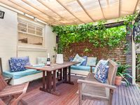 Rear deck with outdoor dining