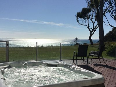 Relax in  the jacuzzi while watching the ocean.