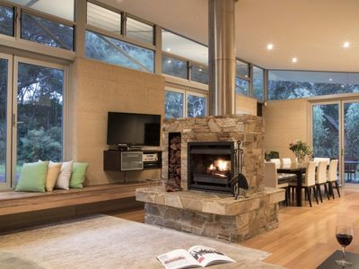 Open Plan Living area with two sided Fireplace overlooking the bush and Kangaroo