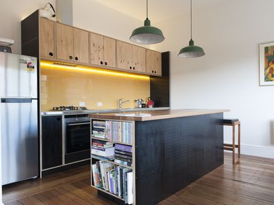 Kitchen with a wooden bench made from the old shed