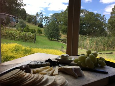 Enjoy a local cheese platter overlooking 4 acres of manicured gardens