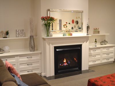 Stunning gas log fireplace which beautifully heats the spacious living area